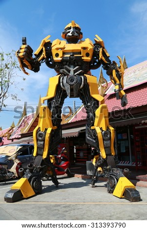 AYUTTAYA,THAILAND - The Replica of Bumblebee robot made from iron part of a Car display at Thung Bua Chom floating market - stock photo