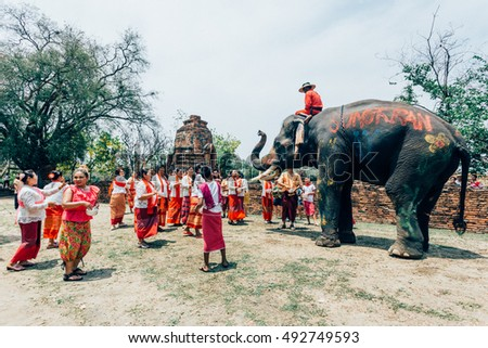 AYUTTHAYA, THAILAND - APR 13: People enjoy water splashing with elephant during Songkran Festival  on Apr 13, 2015 in Ayutthaya,Thailand.
