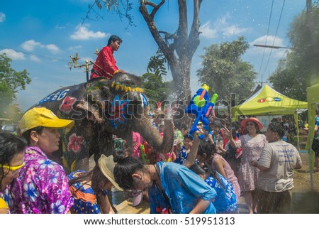 AYUTTHAYA, THAILAND - APR 14: Revelers enjoy water splashing with elephants during Songkran Festival on Apr 14, 2016 in Ayutthaya,Thailand. Water splashing is the way Thai people celebrate New Year.