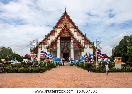 AYUTTHAYA, THAILAND - AUG 15 : Tourists visit famous Wat Mongkol Bophit temple on Aug 15, 2013 in Ayutthaya.  Ayutthaya is former capital of Siam (former Thailand).