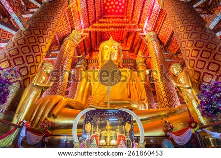 AYUTTHAYA, THAILAND - FEB 24: People work with cloth on Buddha image in Wat Phanan Choeng temple on FEB 24 , 2015  in Ayutthaya, Thailand. Ayutthaya is former capital of Siam (former Thailand).
