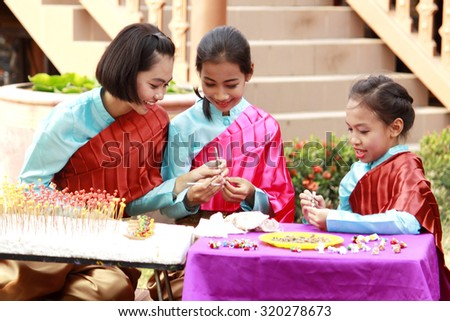 AYUTTHAYA-THAILAND-FEBRUARY 15 : Take a picture of Thai style Lifestyle children & senior relatives at Village doll on February 15, 2015 At Ayuthaya Province, Thailand.