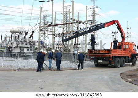 AYUTTHAYA -THAILAND - JANUARY 9 : Area workers. prepare equipment to haul a large transformer in the substation, January 9, 2015 in Ayutthaya province, Thailand