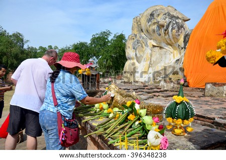 AYUTTHAYA, THAILAND - JANUARY 10 : People come to Wat Lokayasutharam Temple for travel and pray Reclining Buddha on January 10, 2016 in Ayutthaya, Thailand. - stock photo