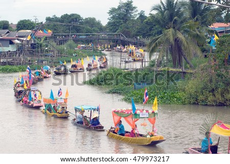 AYUTTHAYA, THAILAND - JULY 15, 2011 : Beautiful flower boats in floating parade, the unique annual Lad Chado candle floating festival of Buddhist lent in Lad Chado canal, Ayutthaya Province,Thailand.
