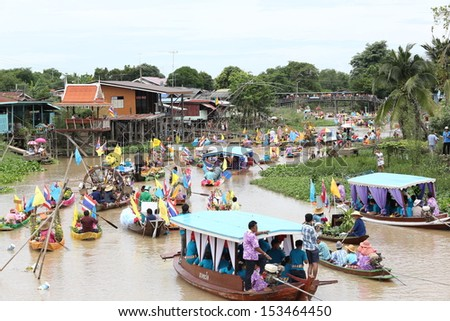 AYUTTHAYA, THAILAND - JULY 22: Beautiful flower boats in floating parade, the unique annual candle festival of Buddhist lent on July 22, 2013 in Ladchado, Ayutthaya, Thailand