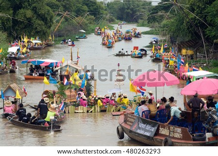 AYUTTHAYA, THAILAND - JULY 15,2011 : people enjoy the candle procession by the river ceremony on The Buddhist Lent Day in Lad Chado candle floating festival ,Ayutthaya Province, Middle of Thailand.