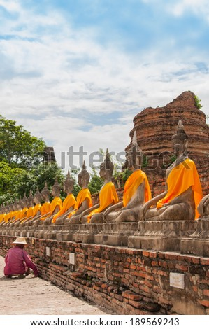 AYUTTHAYA,THAILAND-JUNE 27,2013: Walking around watyaichaimongkol .Some one like to preserve the  archaeological site  by pull or drag weed or unwanted flora