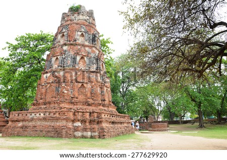 AYUTTHAYA, THAILAND -MAR 26: Tourist visits Wat Chaiwatthanaram in Ayutthaya, Thailand on March 26, 2015. Wat Chaiwatthanaram is a Buddhist temple on the west bank of the Chao Phraya River. - stock photo