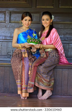 Ayutthaya, THAILAND - October 18 : Unidentified Thailand Women Thailand dressed in a beautiful holding kratong showing of decorate banana leaf on October 18, 2015 in Ayutthaya, Thailand - stock photo