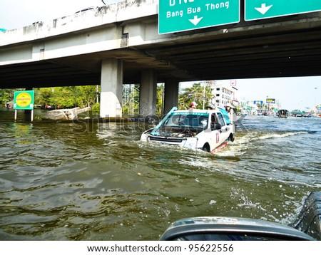 AYUTTHAYA, THAILAND - SEPTEMBER 10: Heavy flooding from monsoon rain in Ayutthaya and north Thailand arriving in Ayutthaya suburbs on September 10, 2011 in Ayutthaya, Thailand. - stock photo
