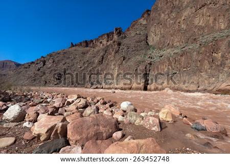 AZ-Grand Canyon National Park-Monument Creek meeting the Colorado River at Granite Rapids - stock photo