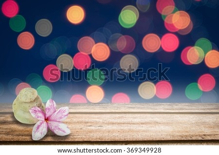 Azalea flowers on wooden table with color bokeh background - stock photo