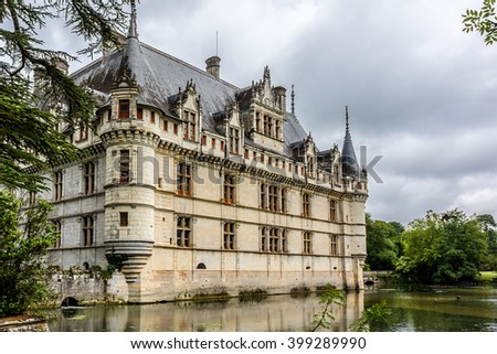 AZAY-LE-RIDEAU, FRANCE - JULY 15, 2012: Chateau Azay-le-Rideau (was built from 1515 - 1527) built on an Island in Indre River - one of earliest French Renaissance chateaux.