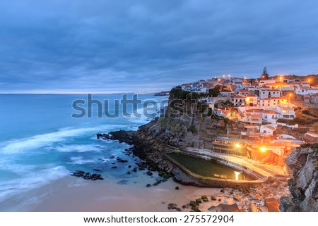 Azenhas do Mar village at dusk with stormy sea and dark clouds, Sintra Portugal - stock photo