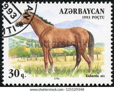 AZERBAIJAN - CIRCA 1993: A stamp printed in Azerbaijan shows a brown, Kabarda breed horse standing in a pasture, circa 1993. - stock photo
