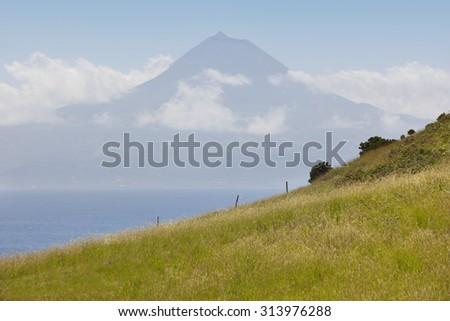 Azores landscape. Pico mountain view from Sao Jorge Island. Portugal. Horizontal - stock photo