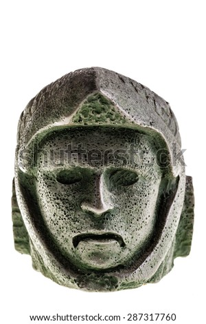 Aztec carved eagle warrior head reproduction isolated over a white background