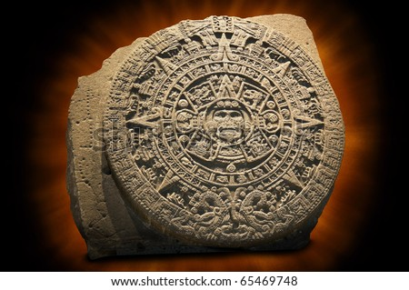 Aztec Sun Calendar.  The Aztec calendar stone is a large monolithic sculpture that was excavated in the Z�³calo, Mexico City's main square, on December 17, 1790 - stock photo