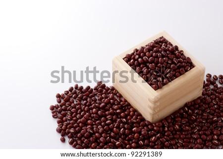 azuki beans in wooden box - stock photo