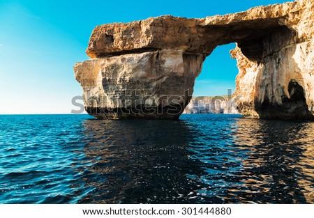 Azure Window, famous stone arch of Gozo island in the sun in summer, Malta. - stock photo