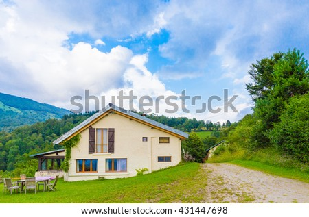 B&B Las Trinquades with view of the Pyrenees and a garden and table and chairs in Boussenac in France - stock photo