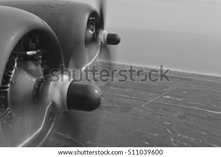 B-17 Bomber in flight, the left hand engines.