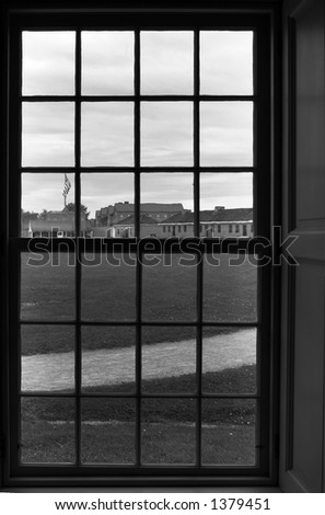 B&W. Center square viewed through officer building window. More with keyword Series08.