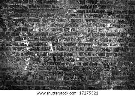 B&w destroyed brick wall - stock photo