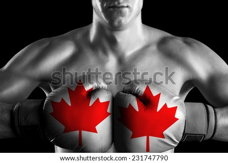B&W fighter with Canada color gloves - stock photo