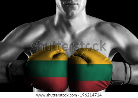 B&W fighter with Lithuania color gloves - stock photo
