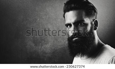 B/w portrait of a handsome bearded man - stock photo