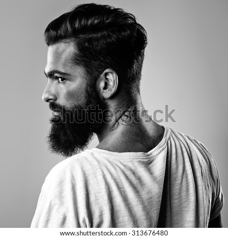 B/w portrait of a handsome bearded man - stock photo