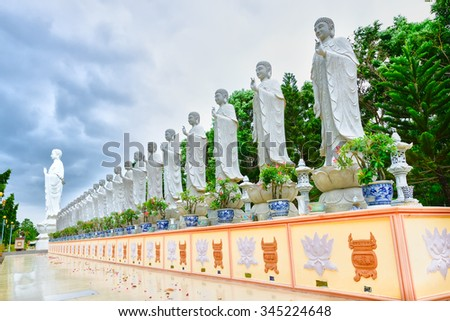Ba Ria-Vung Tau, Vietnam - June 20th, 2014: The beauty of architecture leads to Lord Buddha big statue shining despite thunderstorms in the afternoon Dai Tong Lam Pagoda, Ba Ria Vung Tau, Vietnam