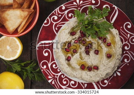Baba ghanoush, levantine eggplant dip with pomegranate and olive oil - stock photo
