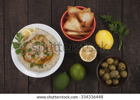 Baba ghanoush, levantine eggplant dish with olive oil and parsley - stock photo