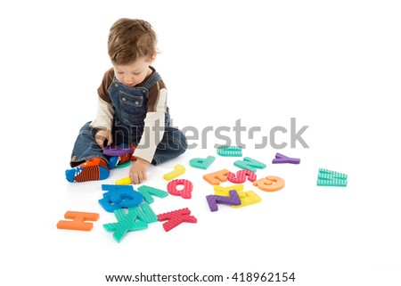 babay plays with letters - stock photo