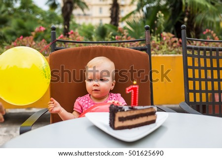 Babies' First Birthday One year old with a cake