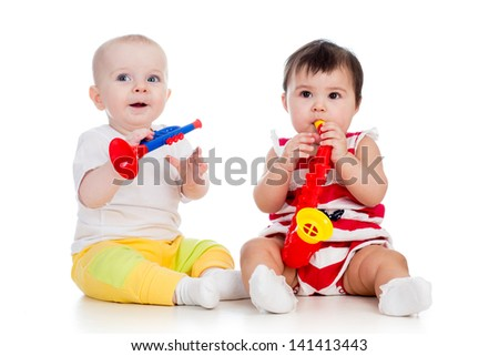 Babies girls play musical toy