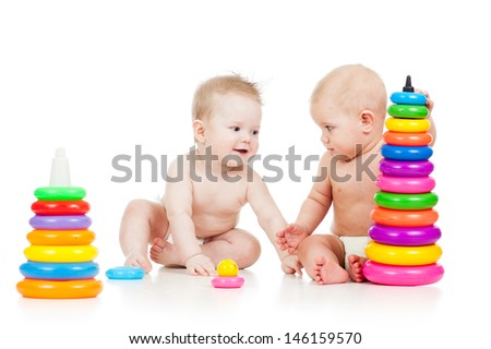 babies play with color developmental toys - stock photo