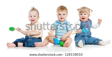 Babies playing with musical toys. Two boys and girl isolated on white. - stock photo