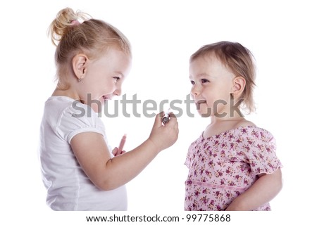 babies with lipstick on white background - stock photo