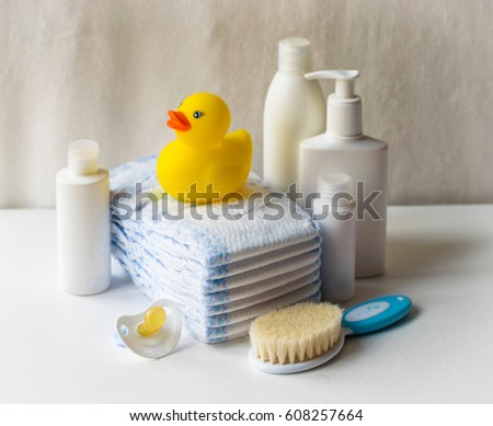 baby accessories for bath with rubber duck on light background