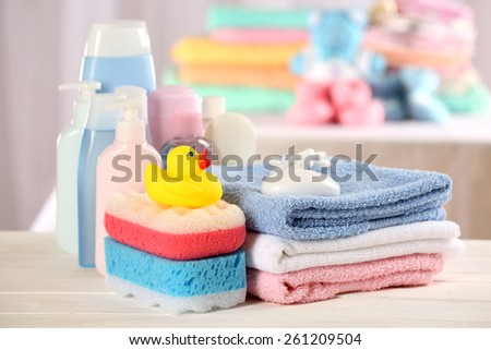 Baby accessories for bathing on table on light background - stock photo