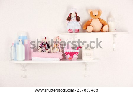 Baby accessories on shelves close-up - stock photo