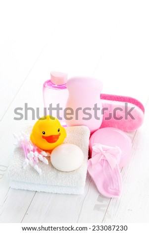 baby accessories on white wood - children - stock photo