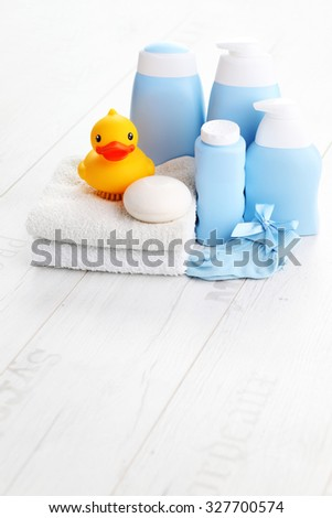 baby accessories on white wood - children - stock photo