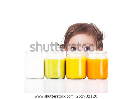 Baby and baby food in the jars made of vegetables - stock photo