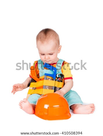 Baby and children's toy instruments on a white background. Child plays with toy tools - stock photo