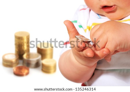 Baby and coin isolated over white. - stock photo